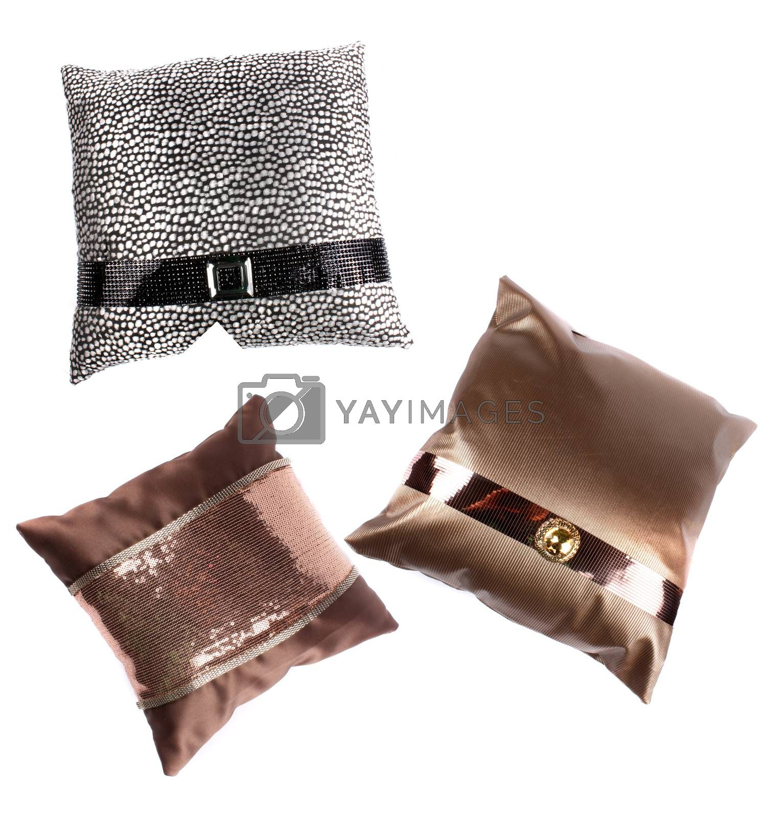 A set of luxurious pillows with beautiful designs, on white studio background.