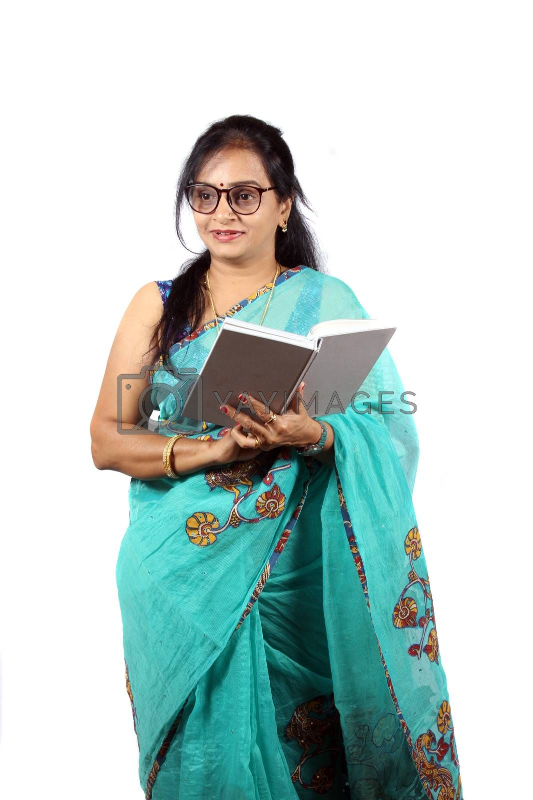 A middle aged Indian teacher in tuquoise saree, on white studio background.