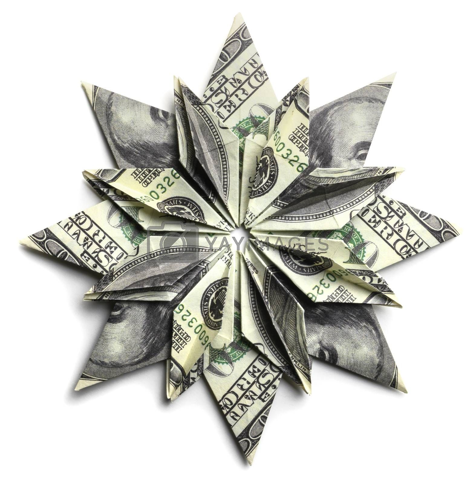 A 100 dollar bill in the shape of a snowflake on a white background.