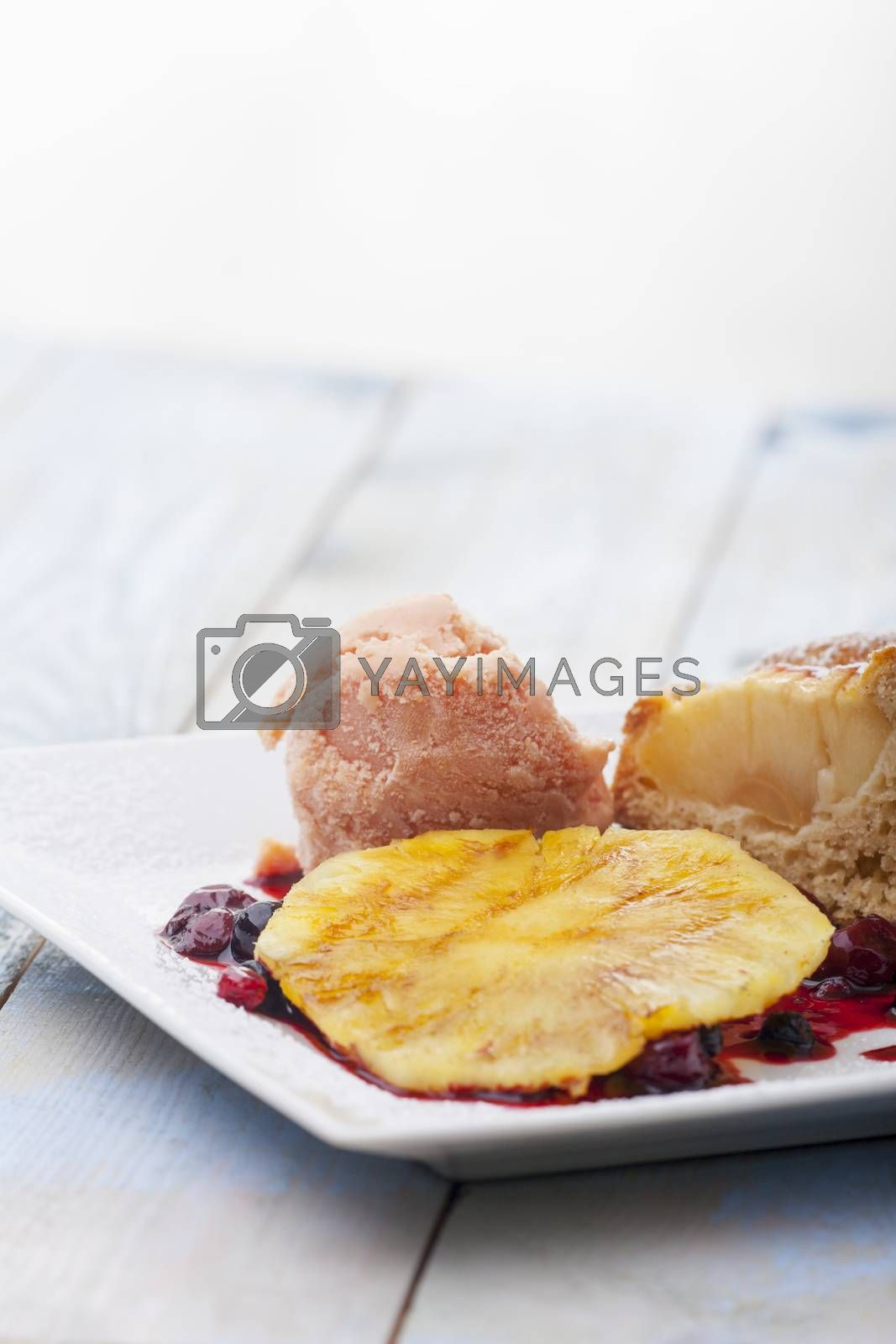 grilled pineapple with ice cream on a plate