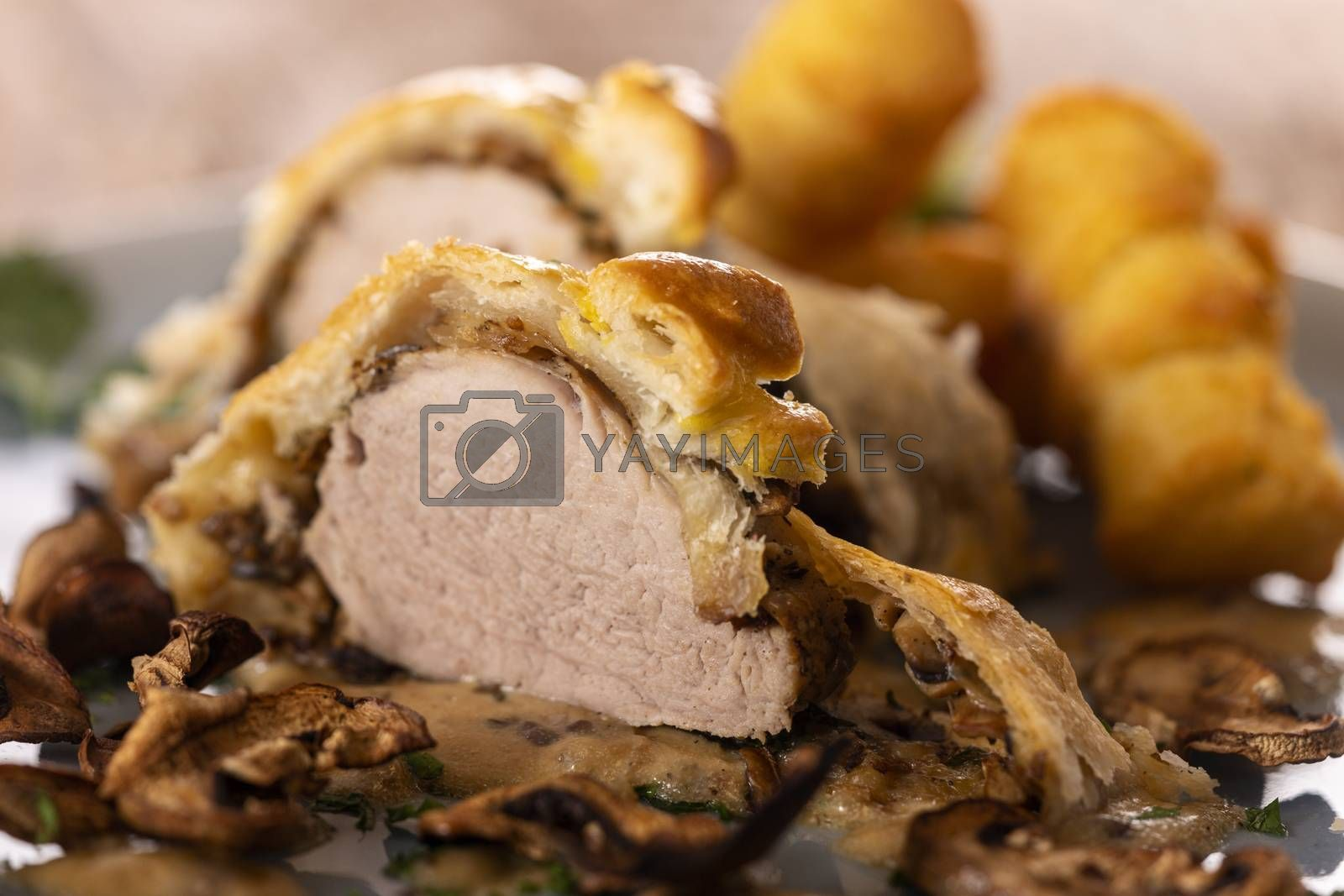 pork filet in puff pastry with croquettes