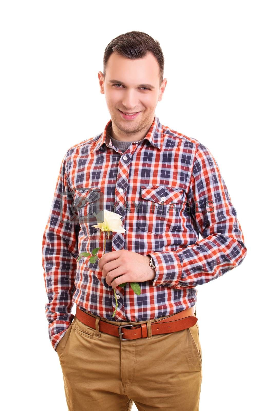 Handsome stylish young man holding a white rose flower, isolated on white background. Valentines day, date, romance concept. Romantic gift. Romantic man. Boyfriend concept.