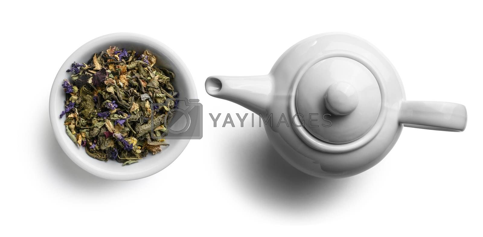Green tea with natural aromatic additives. Top view on white background.