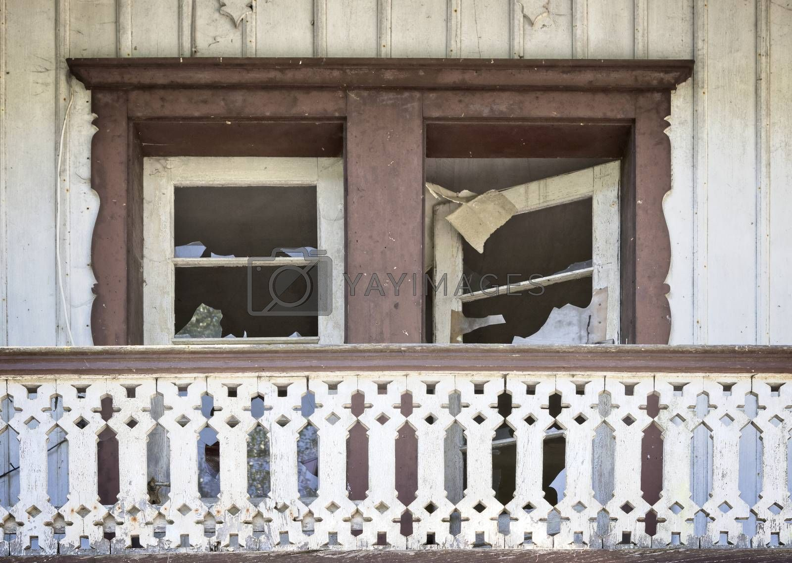 Old broken windows in a wooden ruin