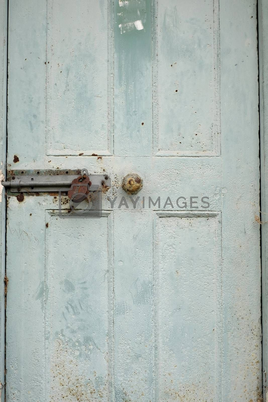 Old closed and locked shaded green door
