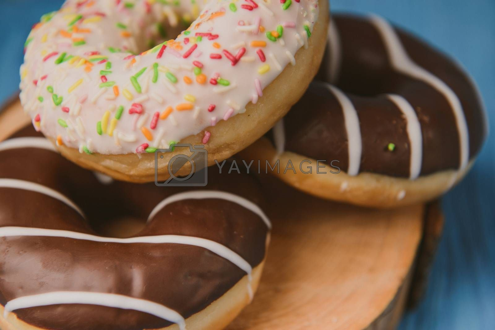 donuts lying on the table. blue background.