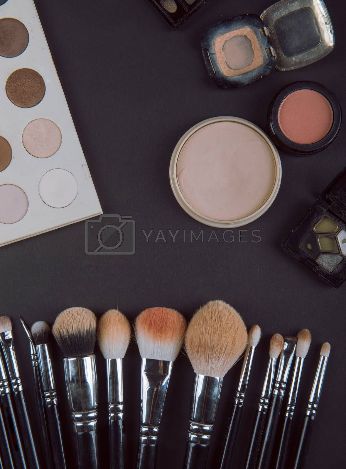 close up of a make up powder and a brush. makeup brush with powder foundation