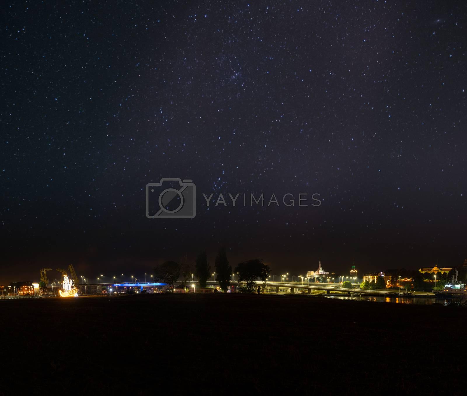 Szczecin. Night view from across the river to the illuminated historic center. Odra river. Chrobry embankments in Szczecin