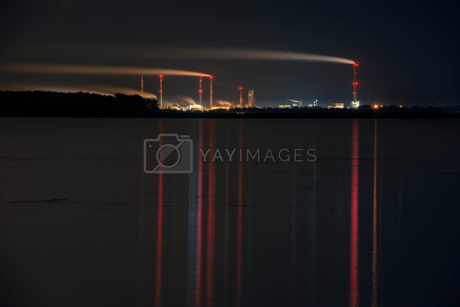 Industrial park at night, Tall chimney with smoke. Police Poland.