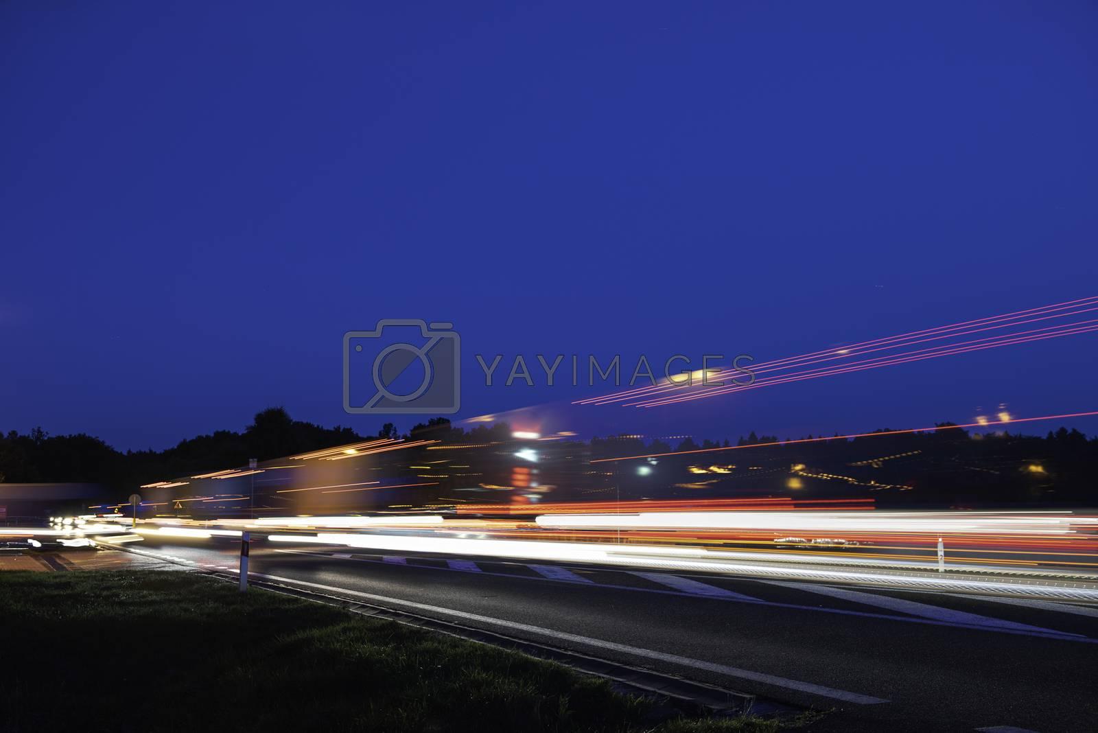 Speed Traffic - light trails on motorway highway at night, long exposure