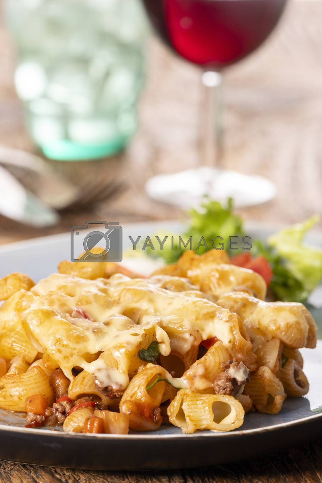 portion of a pasta gratin on wood