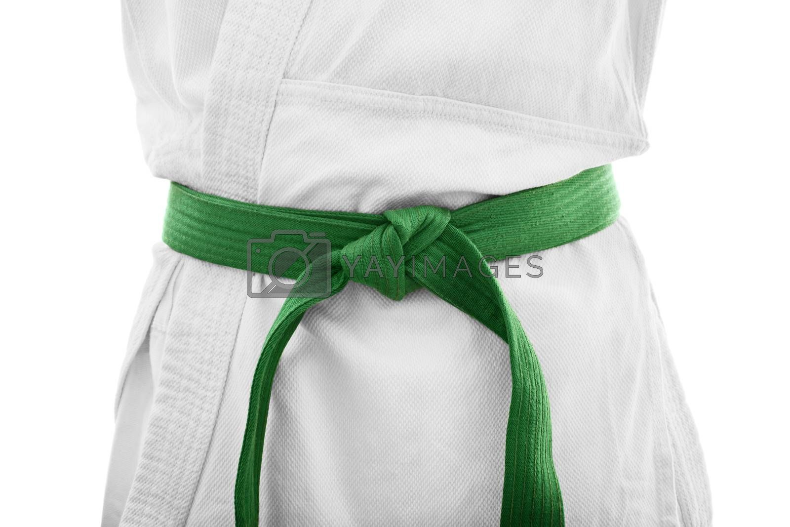 Green belt karate. Close up shot of the mid section of a martial arts fighter in white kimono with green belt, isolated on white background.