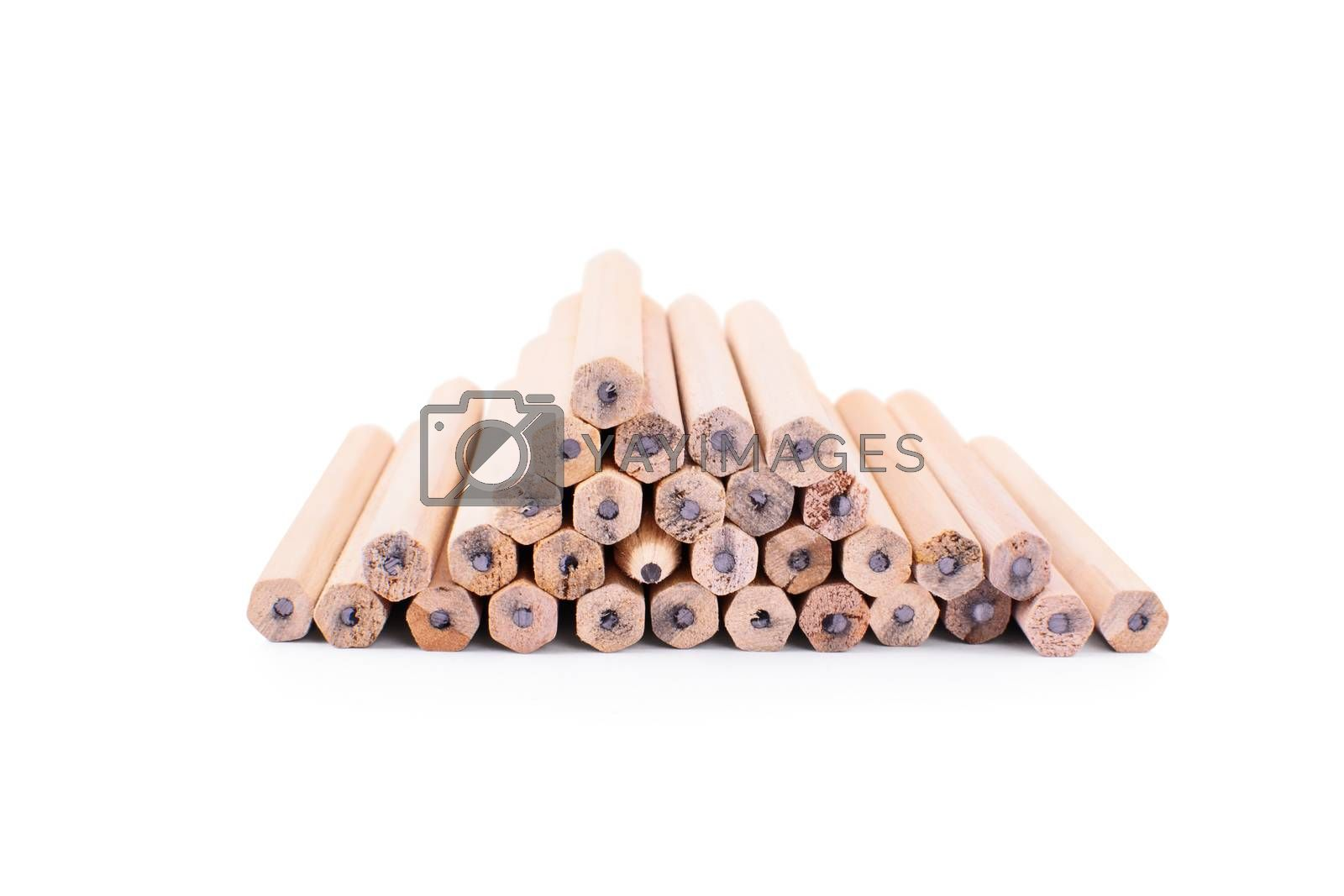 One makes a difference. Pencils stacked on top of each other in the form of a pyramid with one turned with the tip towards the camera, isolated on white background.