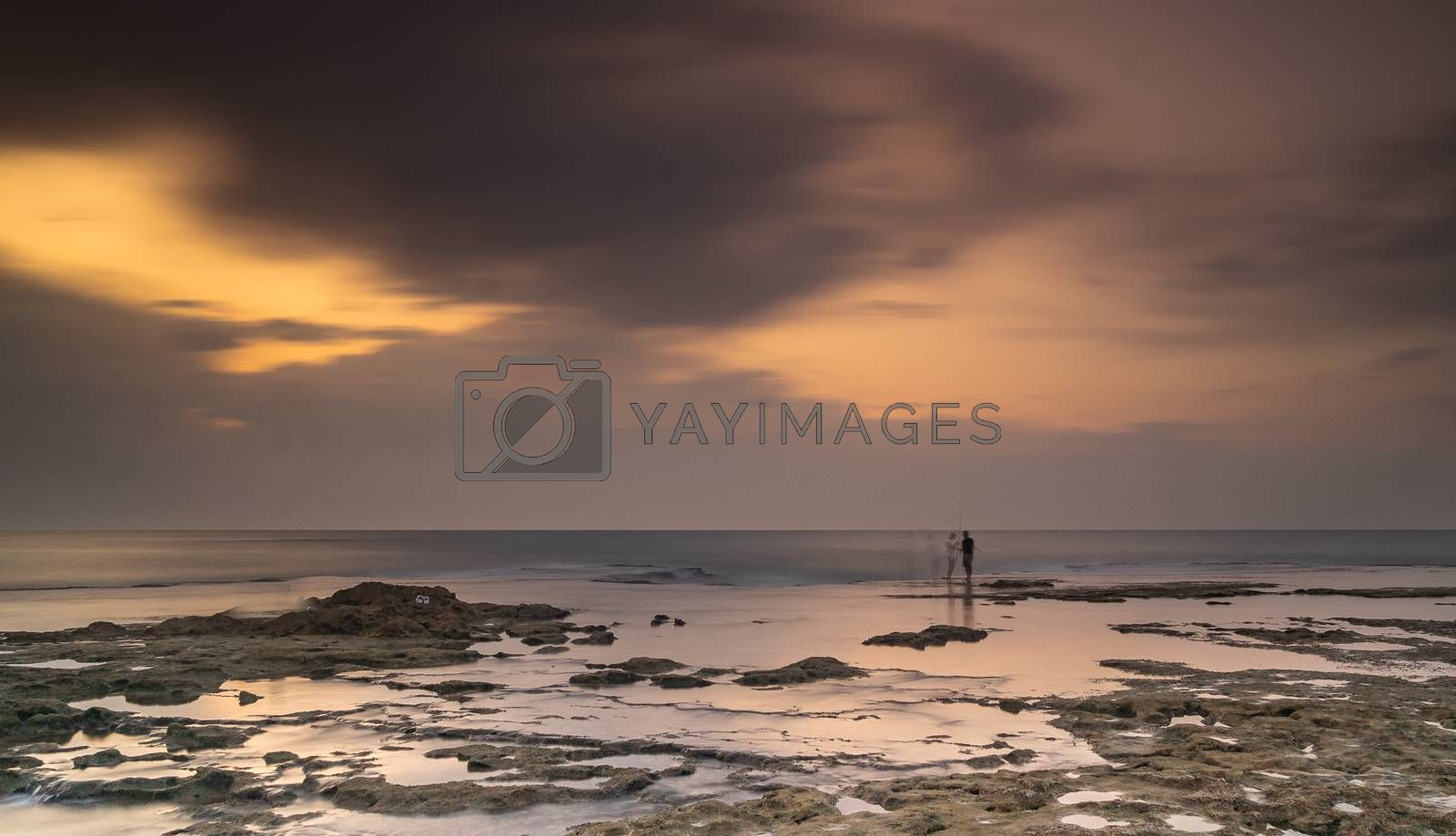 Dramatic clouds under water and windy weather sunset