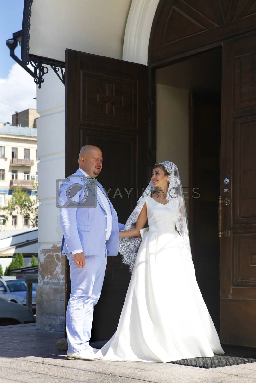 Newlyweds enter the church for the ceremony