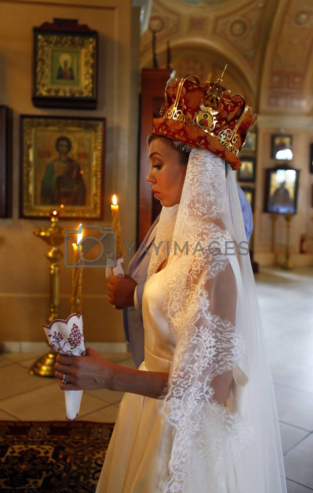 The beautiful wedding ceremony in the Russian Church. Moscow, Russia