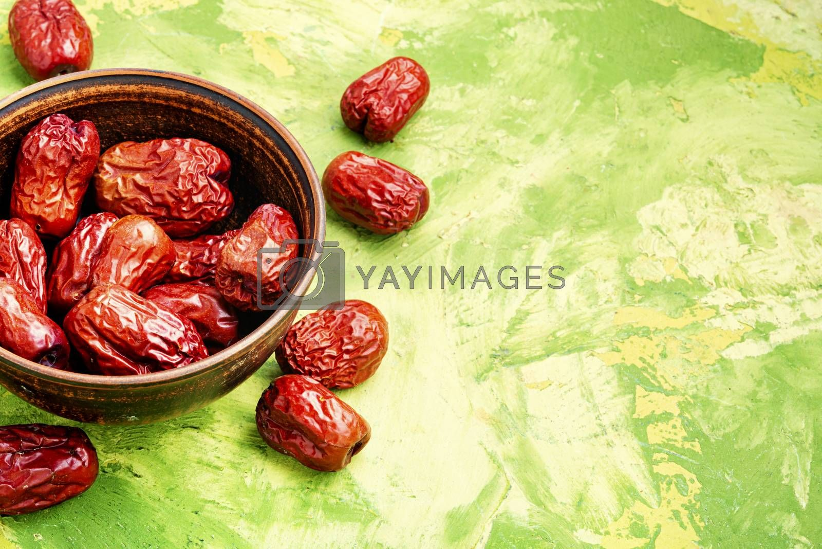 Bowl of dried unabi fruit or jujube.Space for text