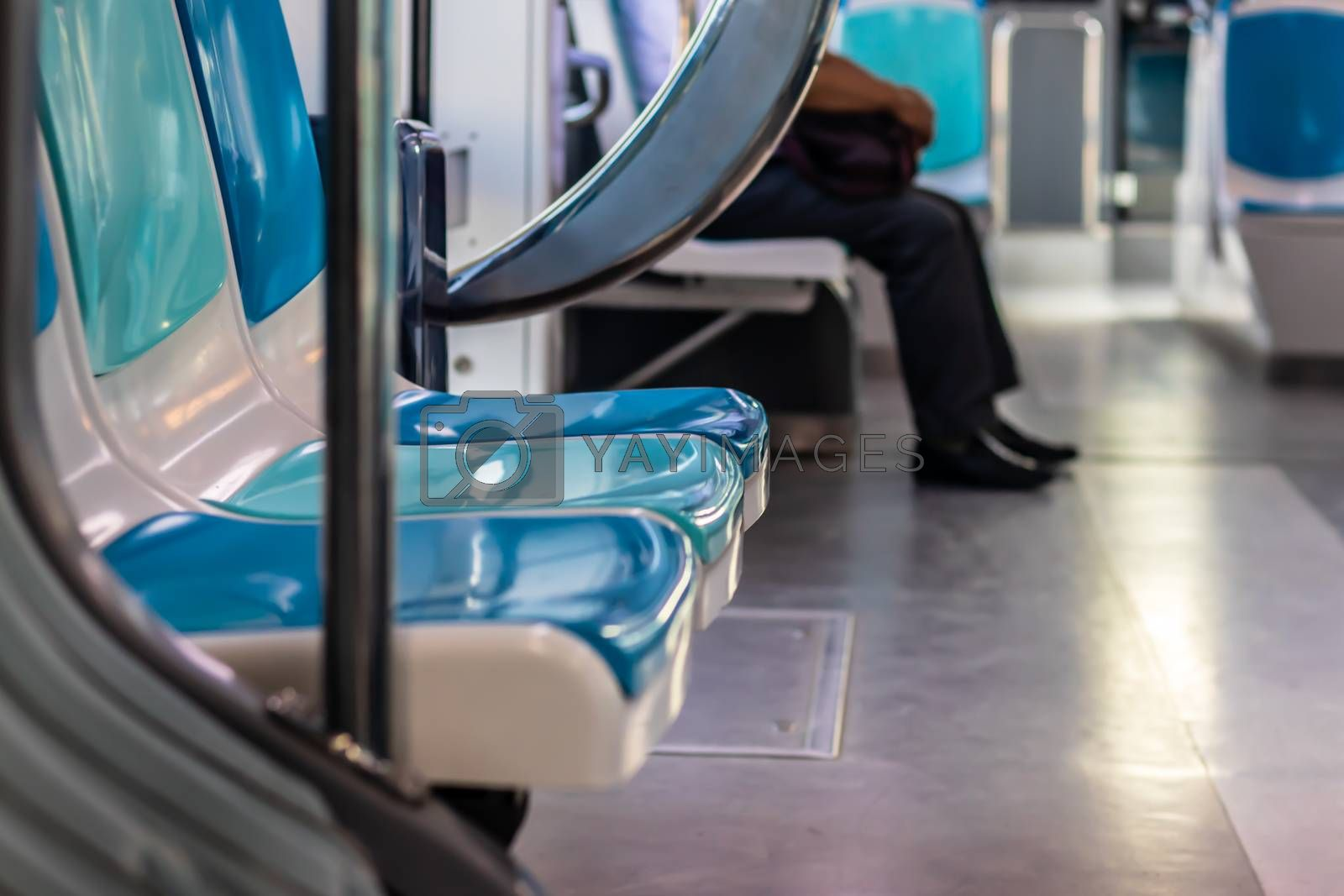 a closeup shoot from a tram with few peoples and empty seats - there is no face can be recognized. photo has taken at izmir/turkey.
