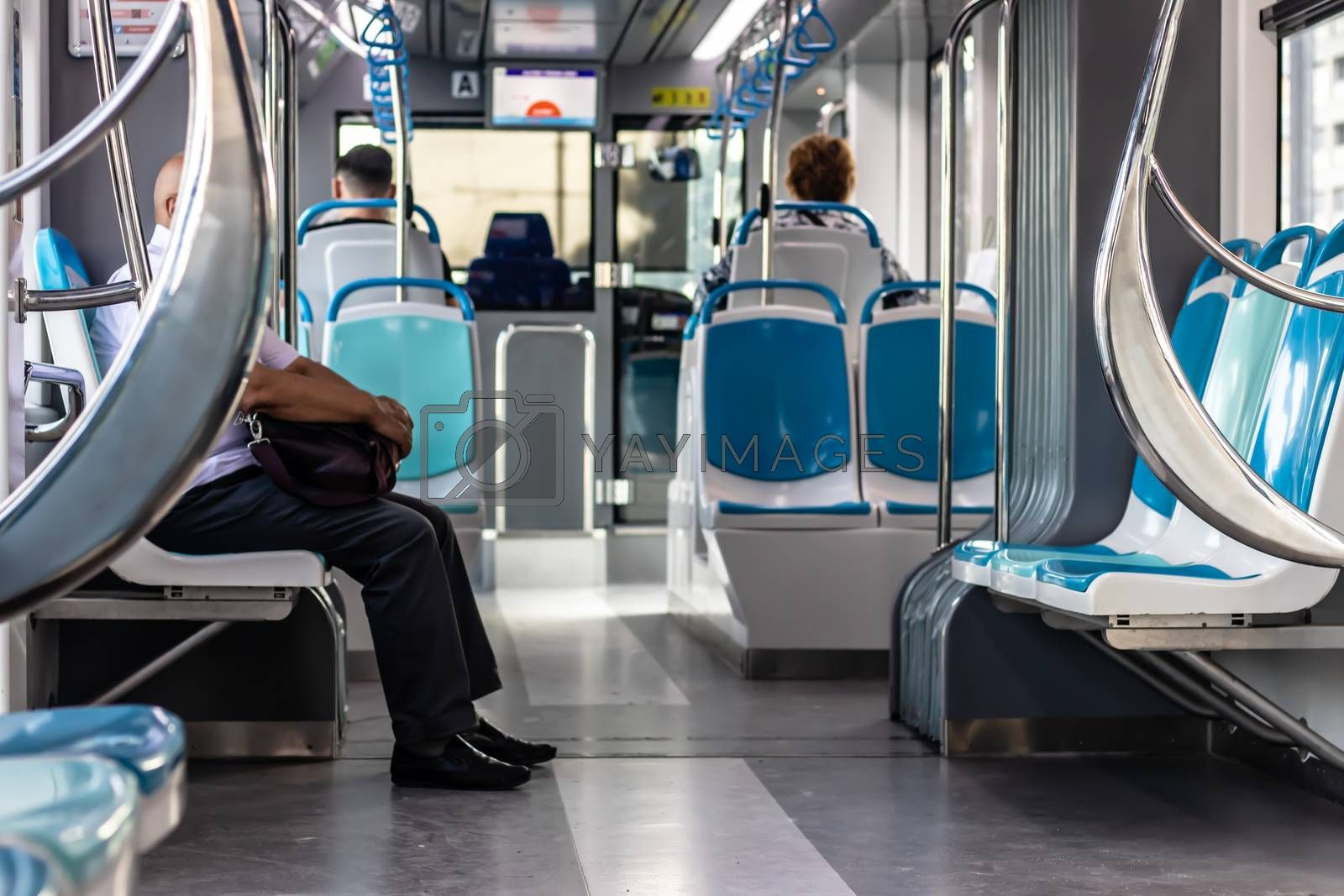a sneak shoot from a tram with few peoples and empty seats - there is no face can be recognized. photo has taken at izmir/turkey.
