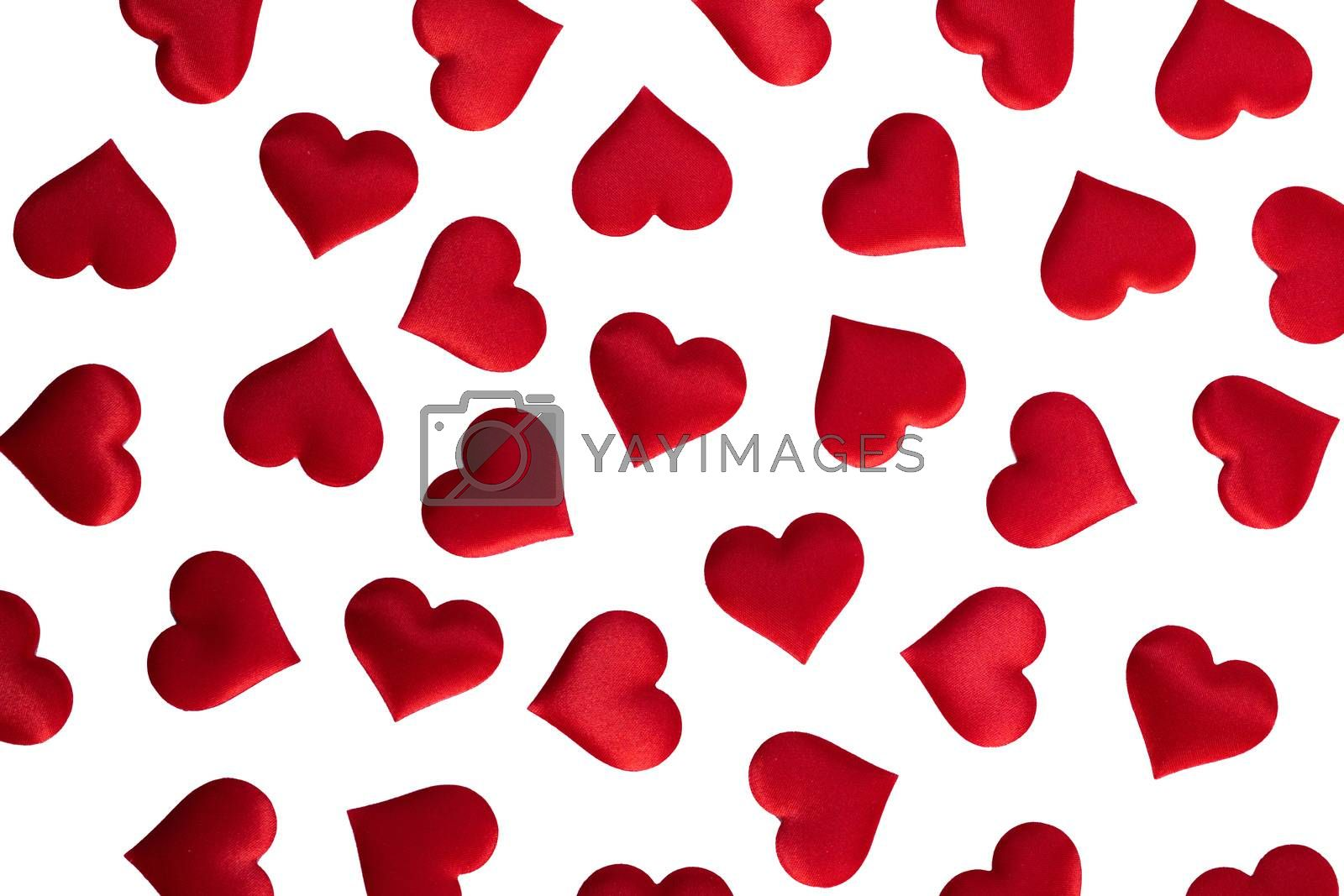 Valentine's day many red silk hearts isolated on white background, love concept