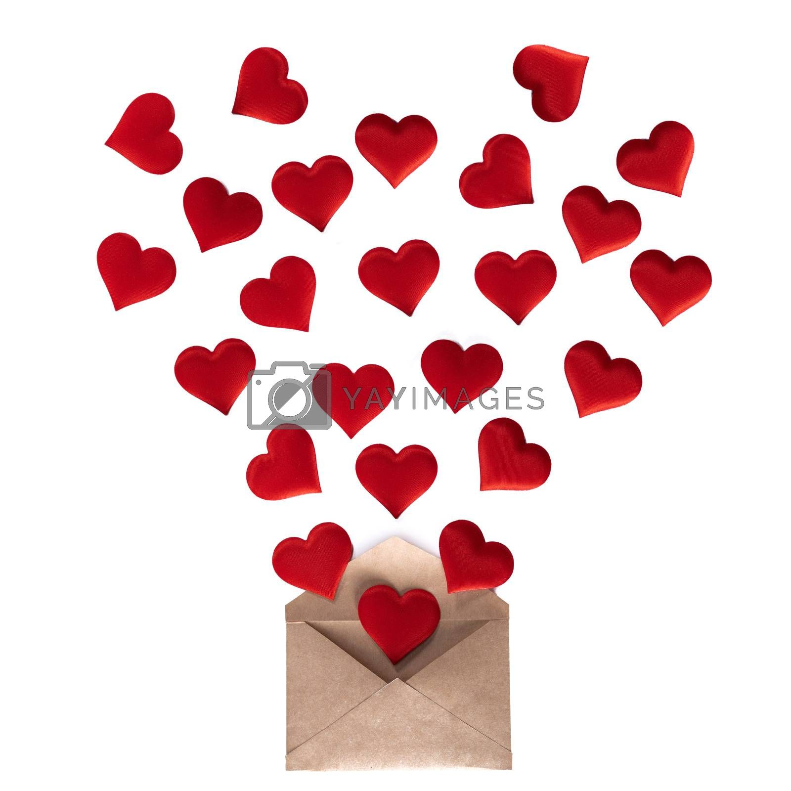 Valentine day love letter, envelope of craft paper with red hearts heap spread on white background.