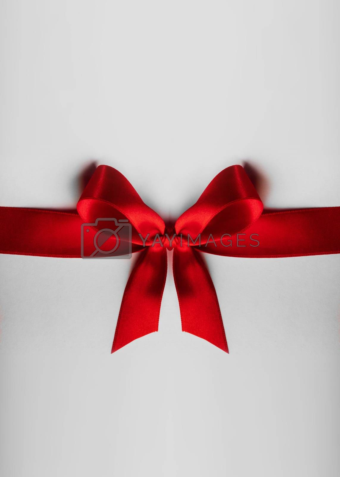 Red satin ribbon bow on white background