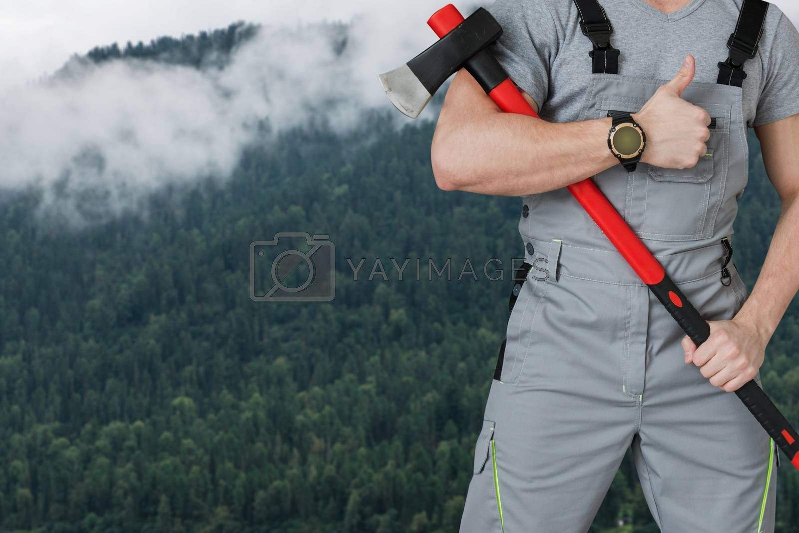 Lumberjack in the woods with an ax, closeup photo