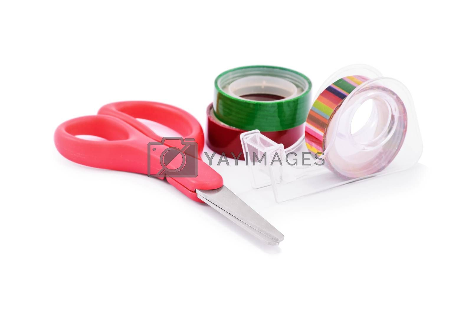 DIY gift wrapping concept. Close up of colorful washi tapes and red scissors, isolated on white background.