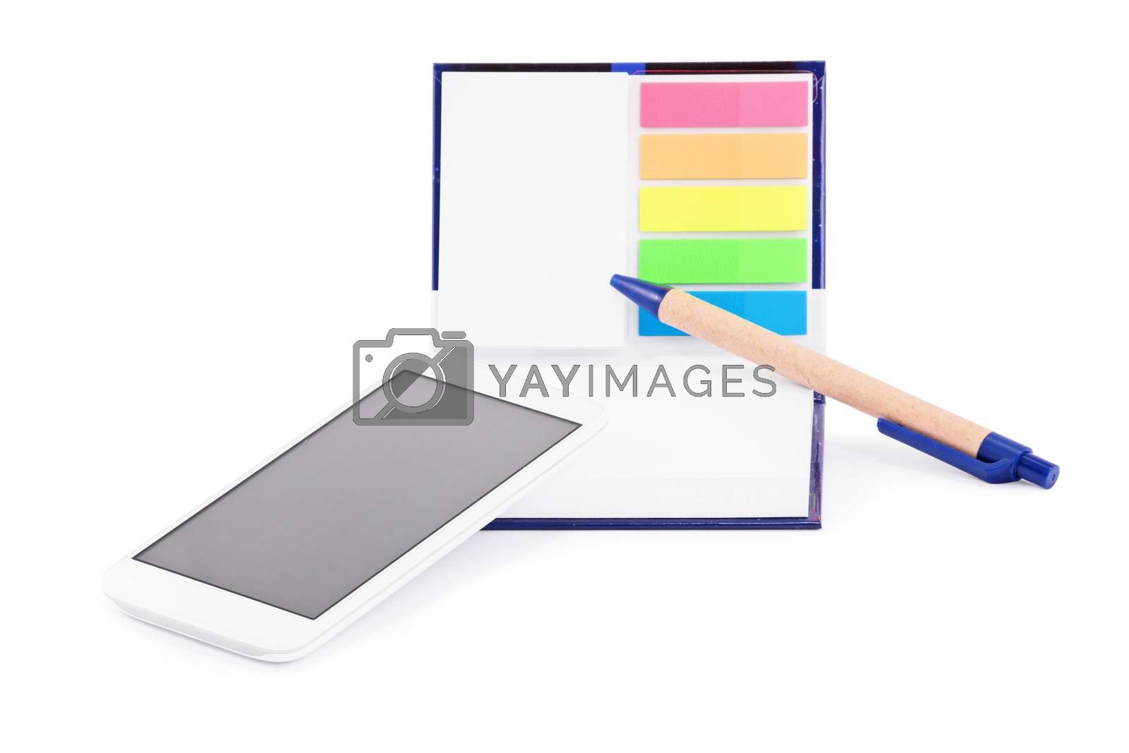 Close up of a notebook with colorful page marker stickers, mobile phone and a pen,  isolated on white background.