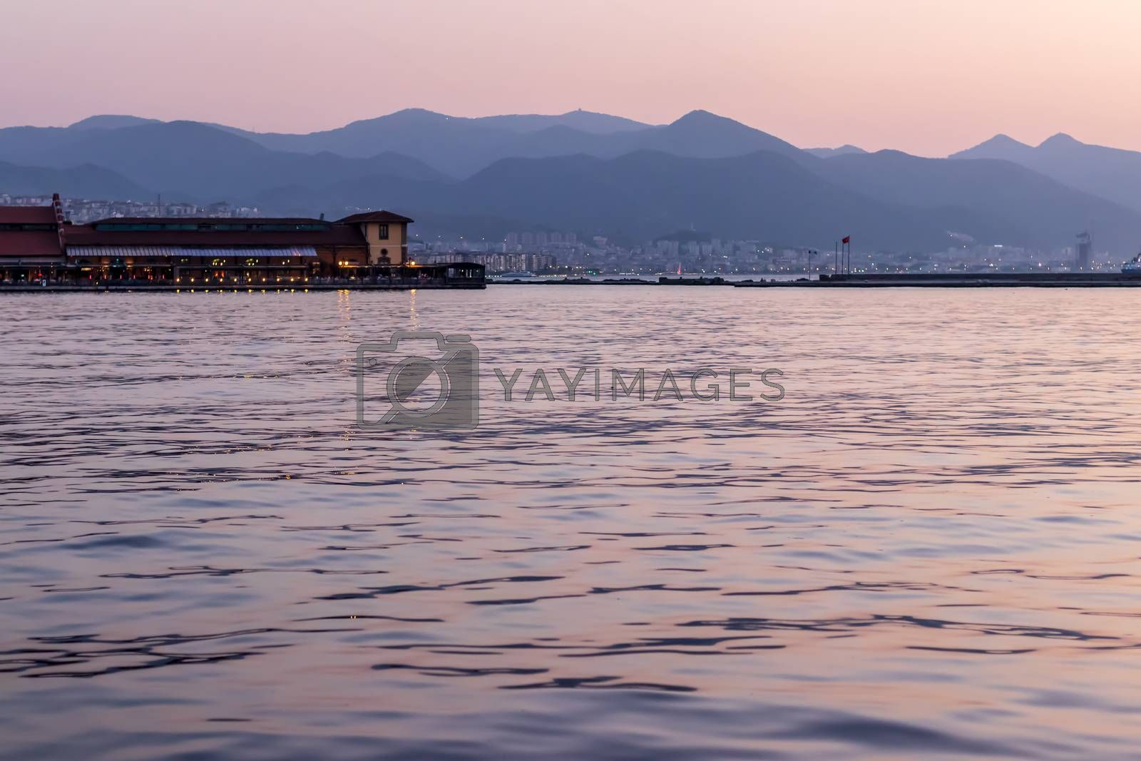 a well composed long exposure seascape shoot - there is a bay which used as restaurant. photo has taken at izmir/turkey.