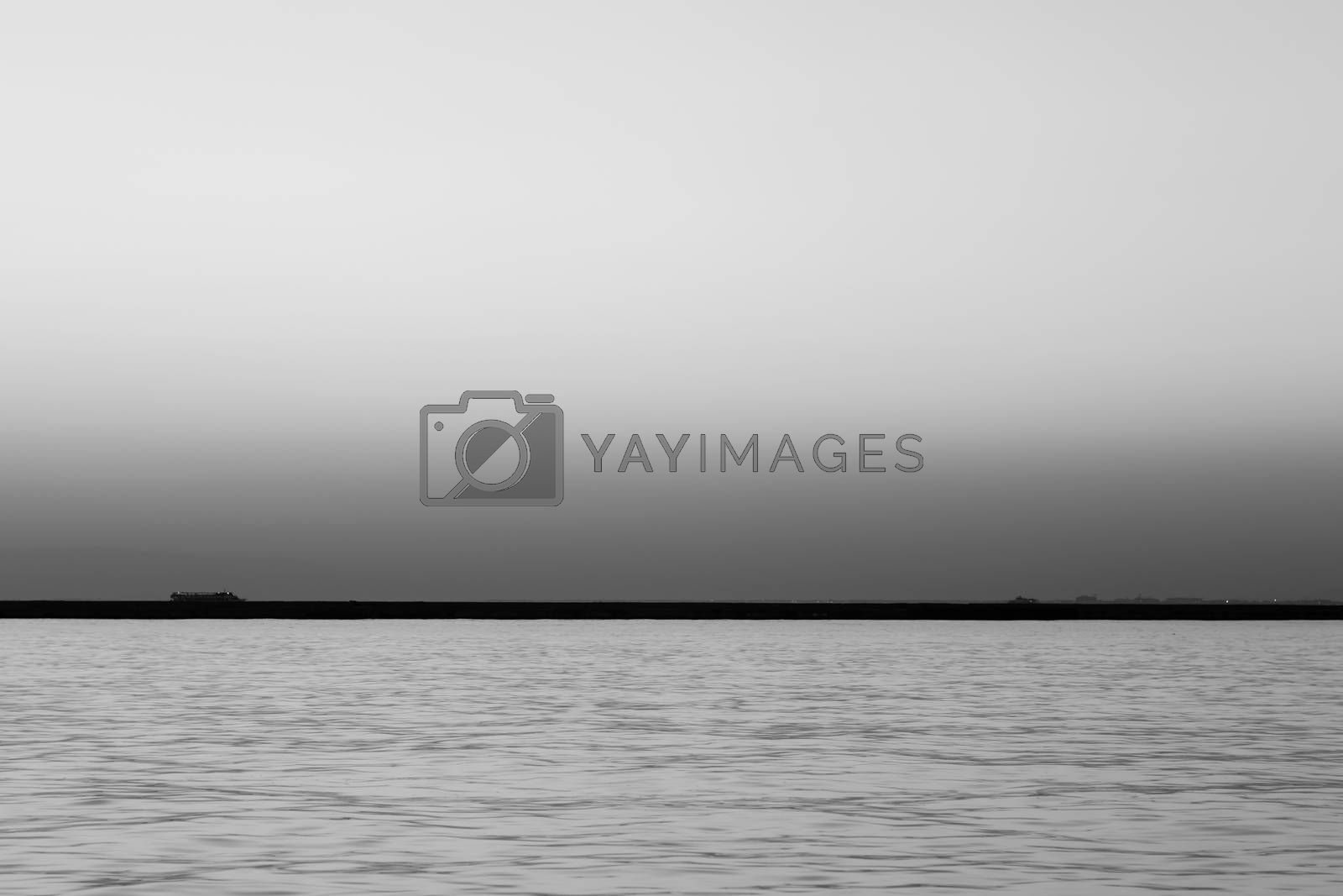 a wide seascape shoot with very well composed colors and black horizon from izmir bay - black and white. photo has taken at izmir/turkey.
