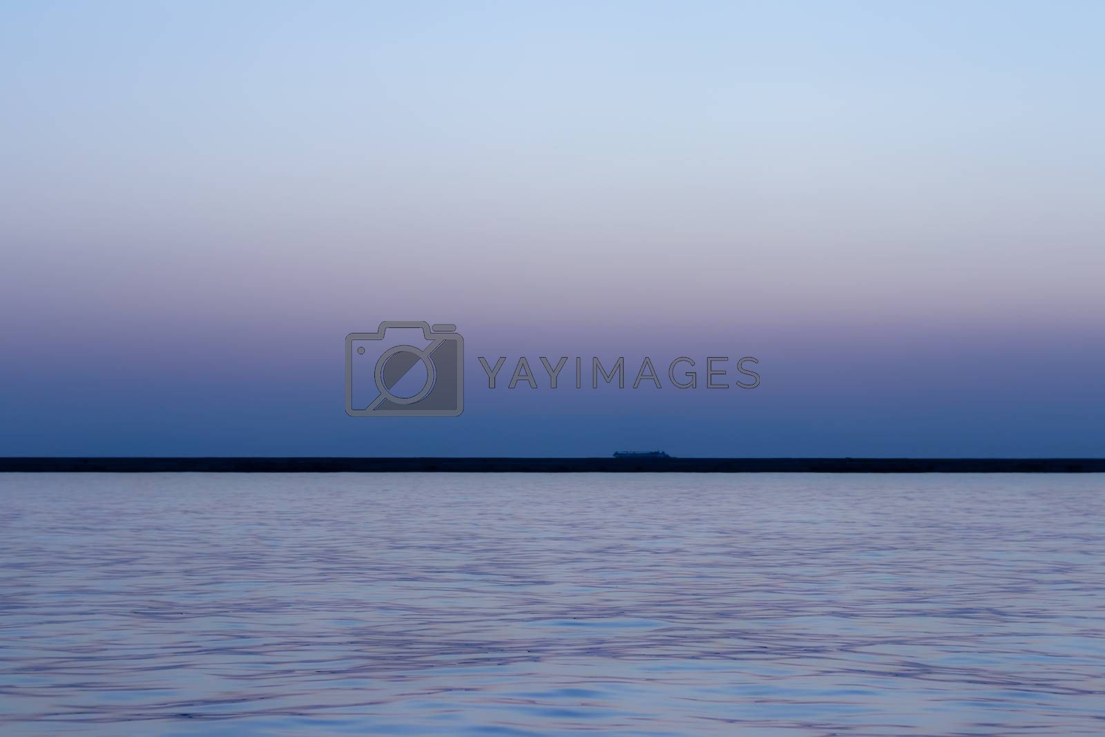a wide seascape shoot with very well composed colors and black horizon from izmir bay - blue color dominated. photo has taken at izmir/turkey.
