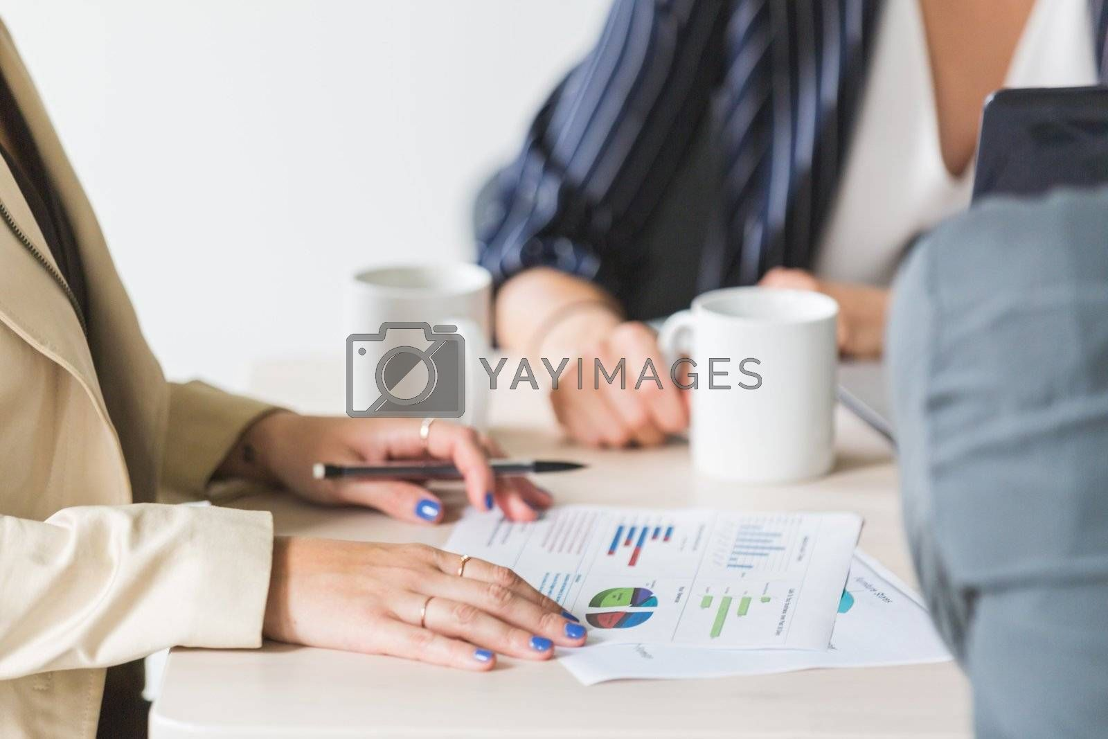 Reading charts at business meeting in a office