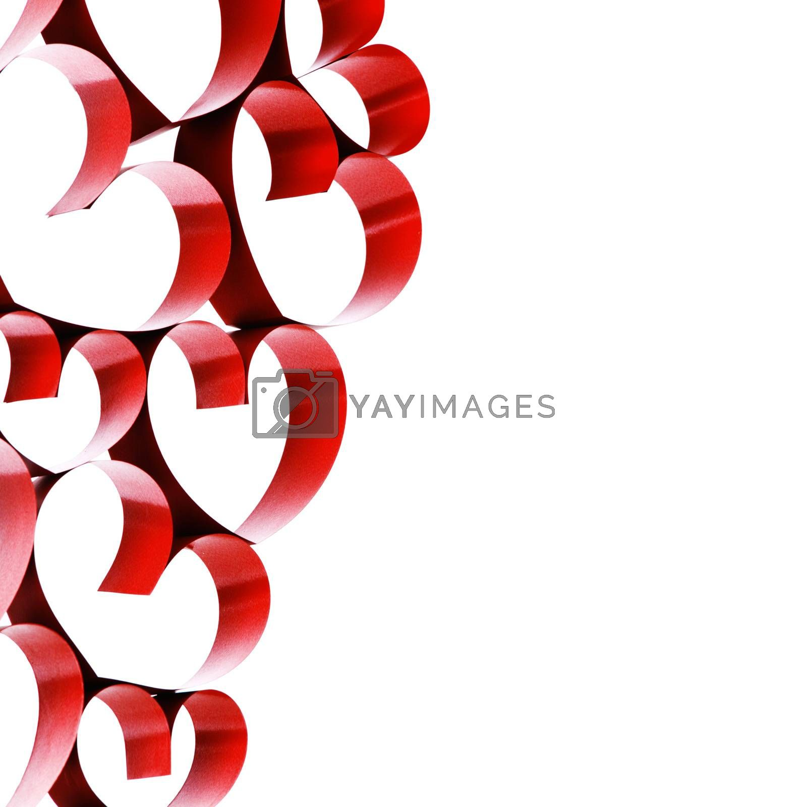 Linked red ribbon hearts isolated on white background