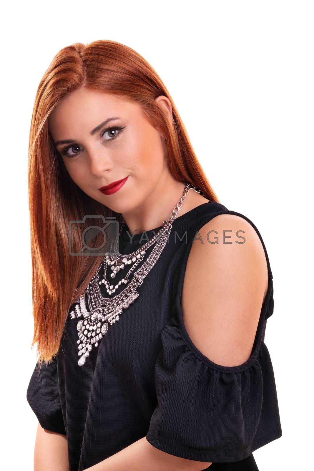 Head shot of a beautiful, attractive redheaded young woman with clean make up, stylish black blouse and modern silver necklace, isolated on white background. Fashion and beauty concept.