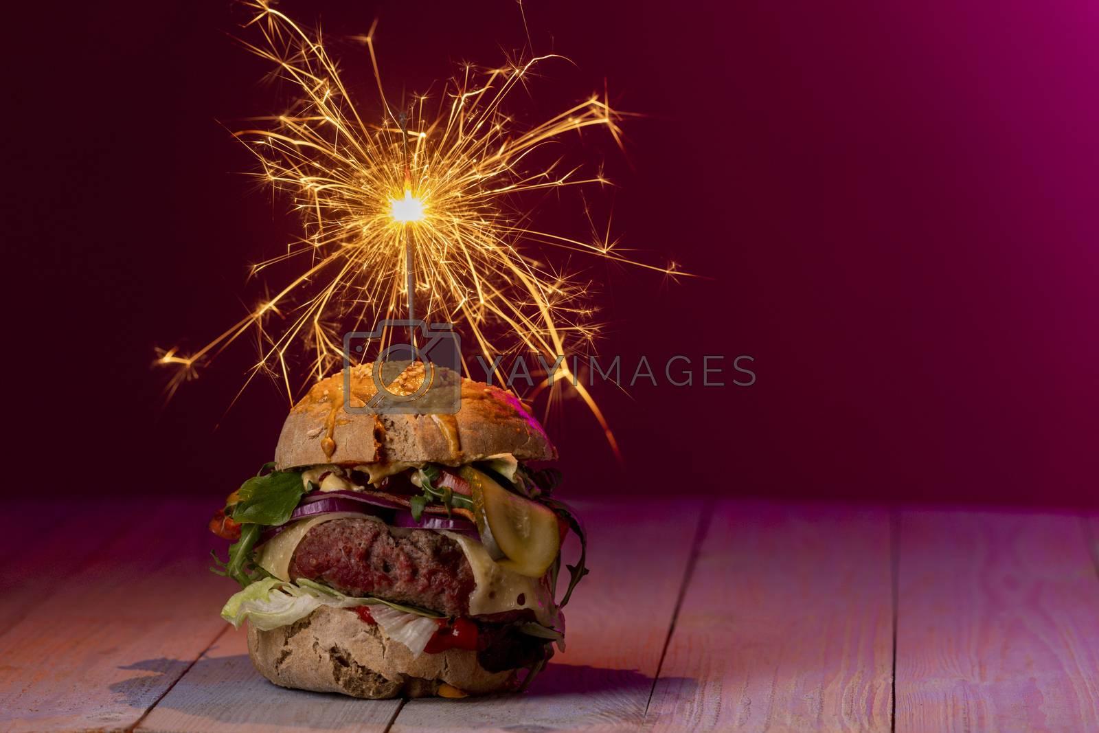 home made cheeseburger on dark wood