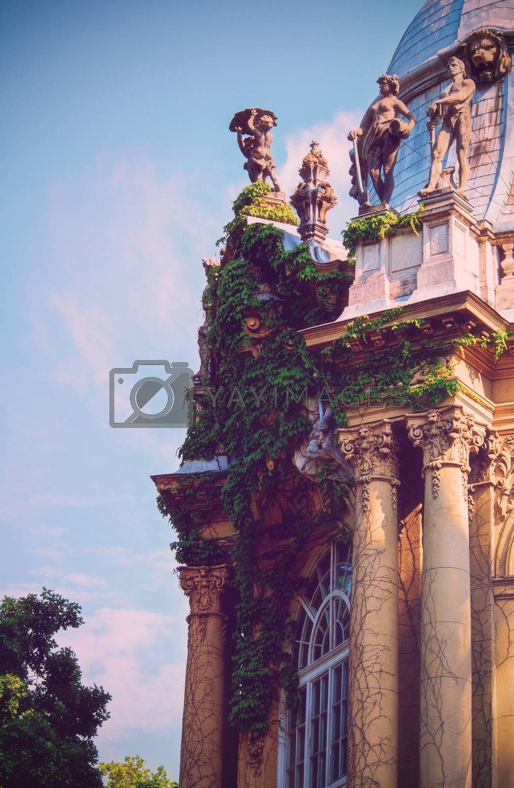 Beautiful side view of the pillars and sculptures of Vajdahunyad Castle, currently the agricultural museum in Budapest, Hungary.