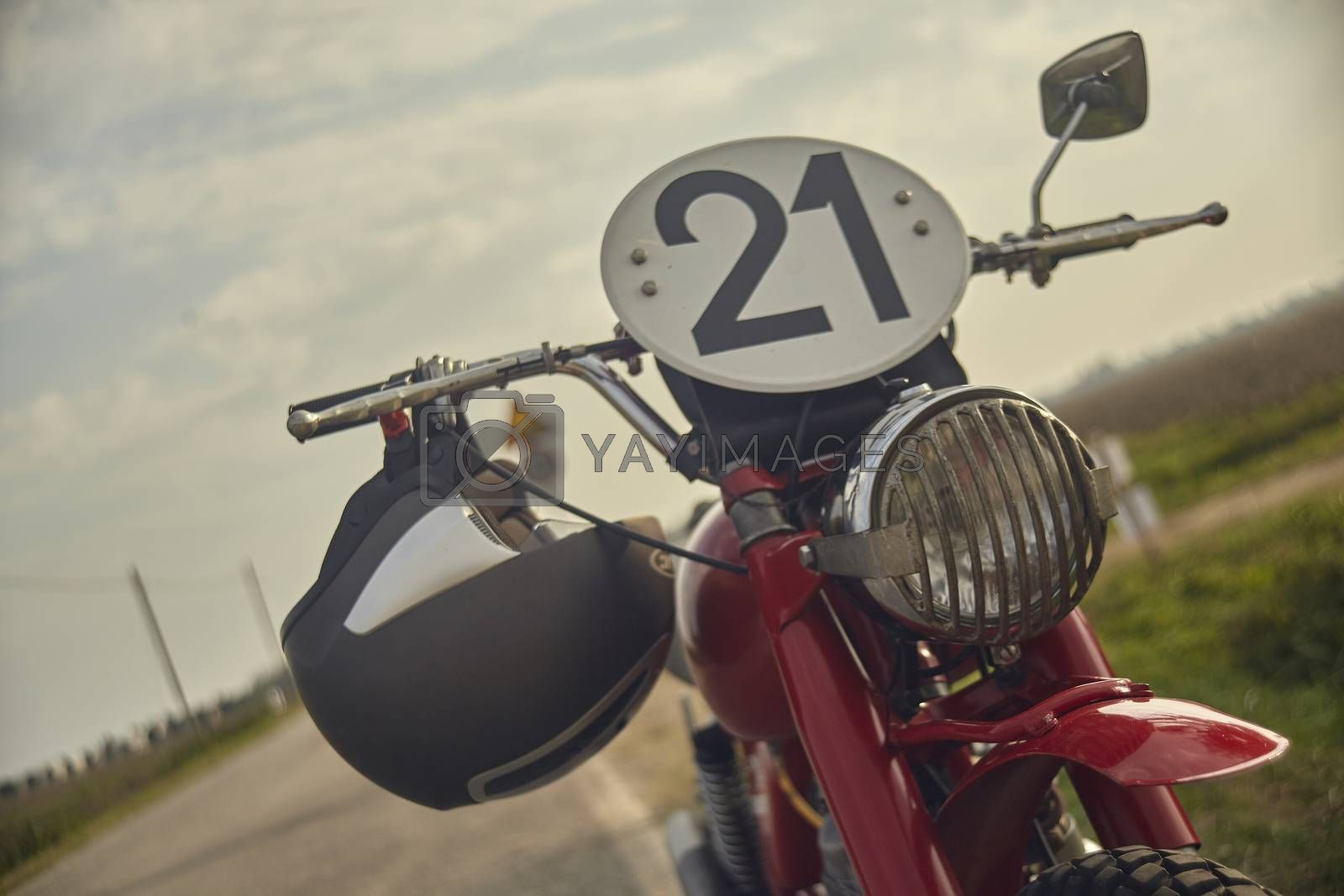 Detail of the front and handlebars of a very old cross bike with the number plate 21