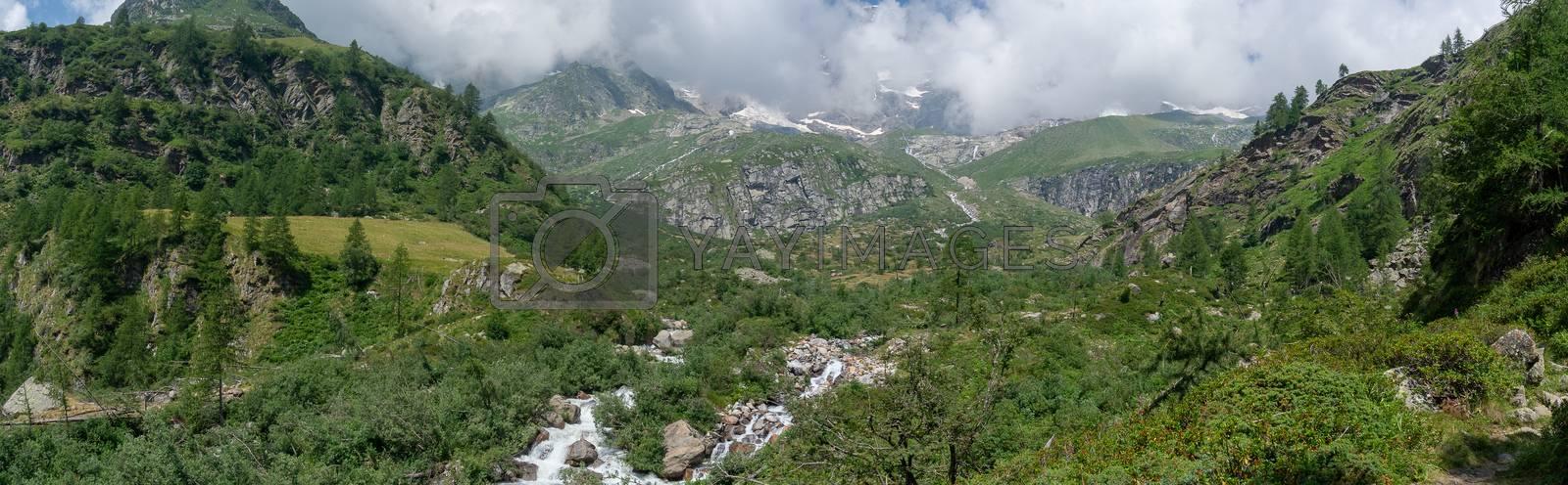 Hiking for health in Italian alps landscape