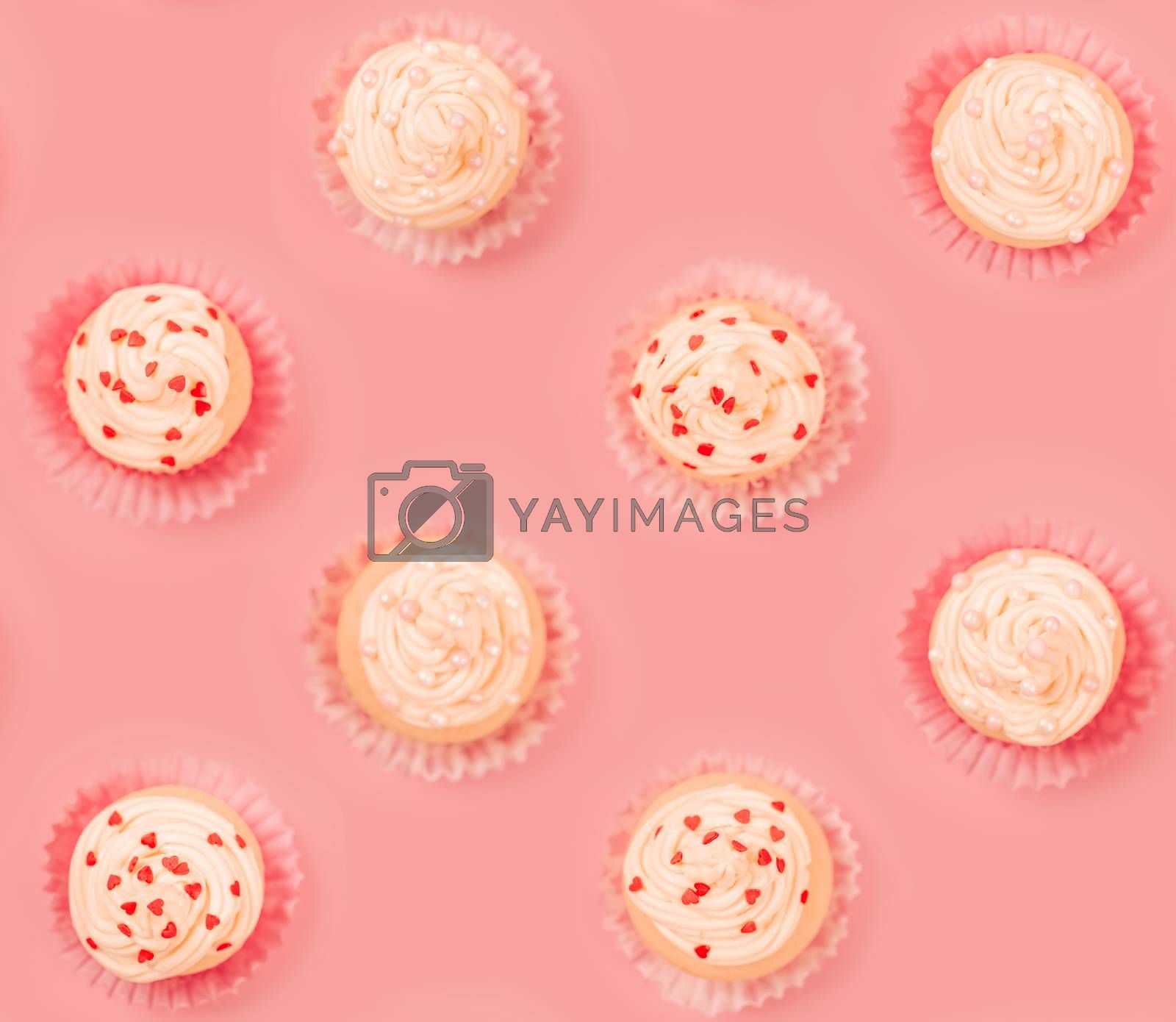 Valentine day love cupcake decorated with cream and hearts on pink background seamless tile food pattern