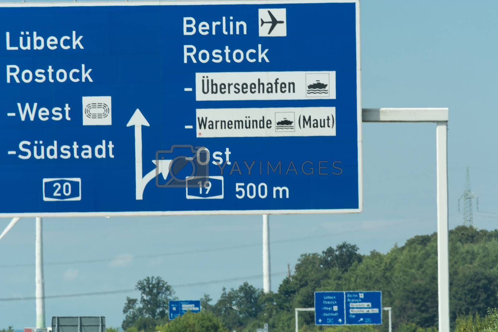 Autobahn sign in Germany Caption on German - city names Berlin, Rostock, Lübeck