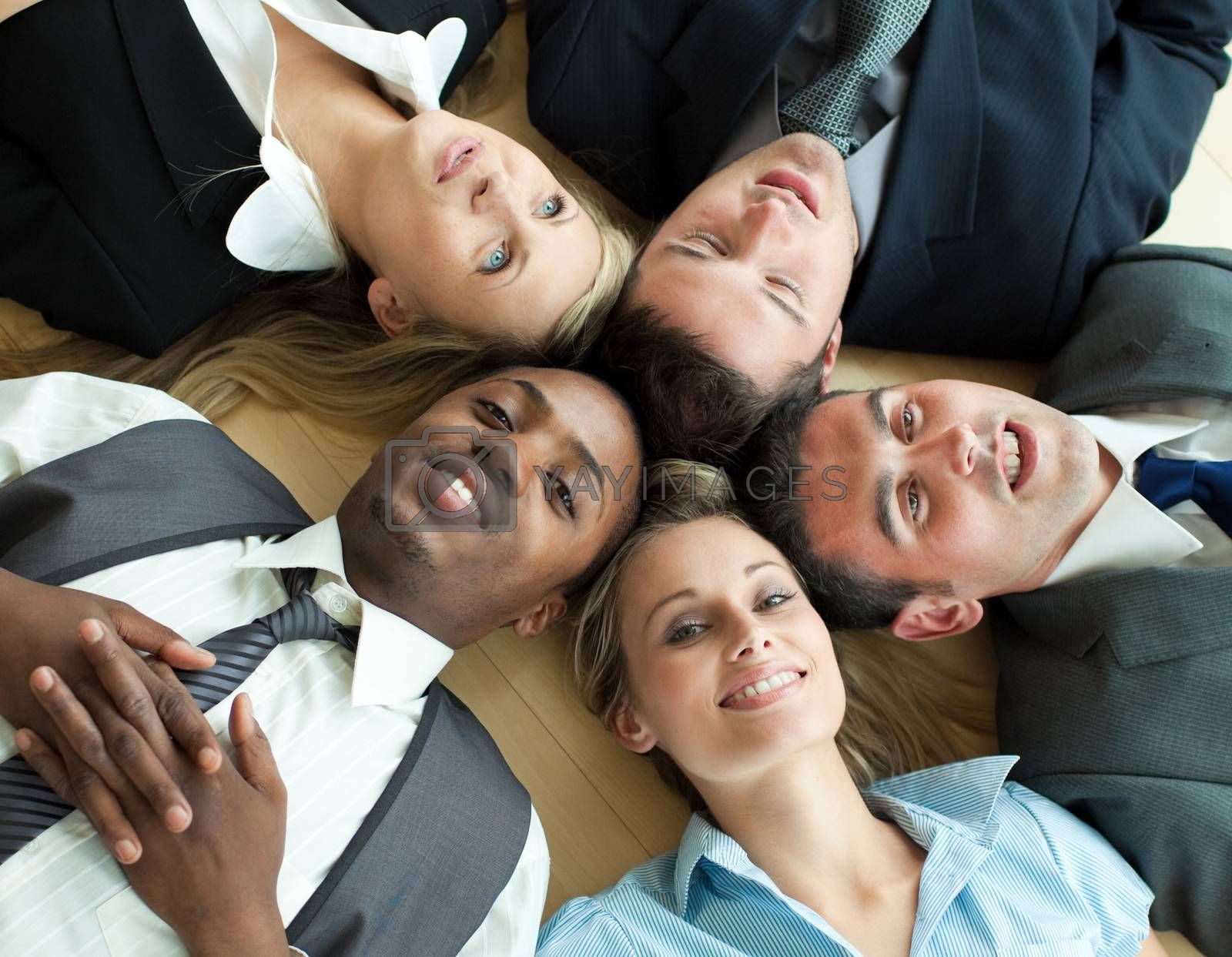 Closseup of Business people lying in a circle on the floor of the office