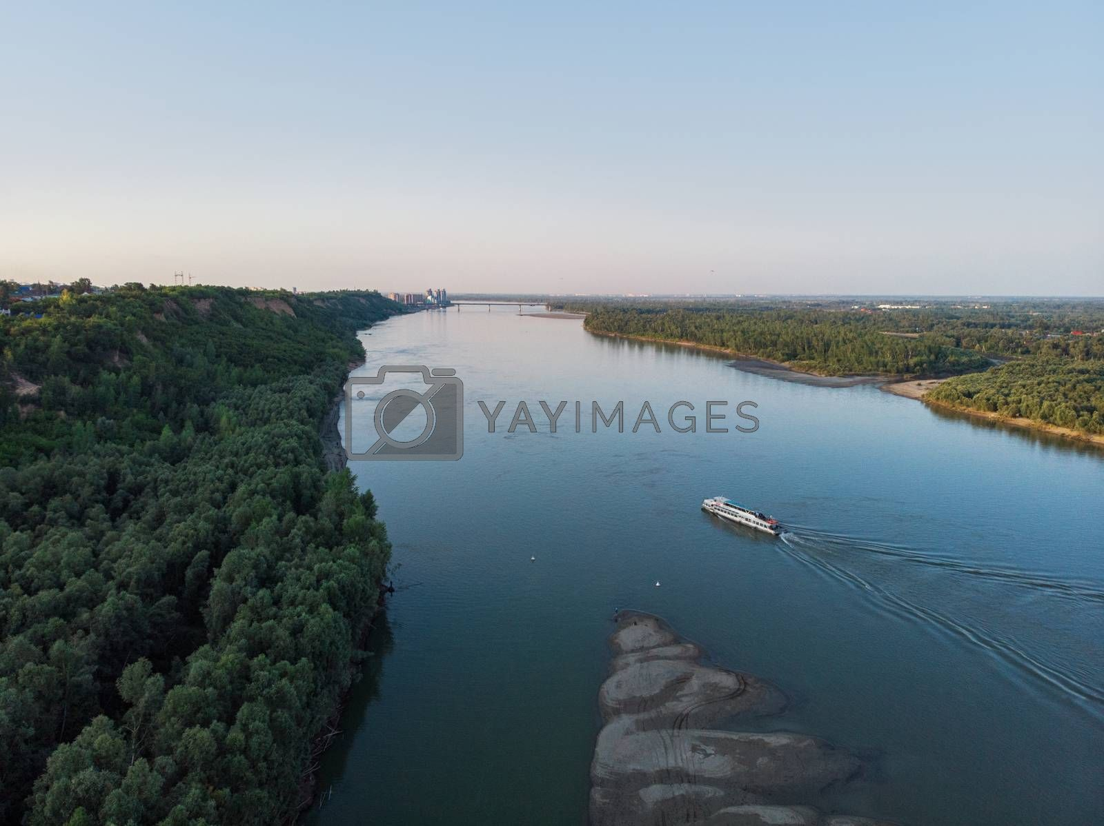 Aerial view of big siberian Ob river and ship, summer day, drone shot