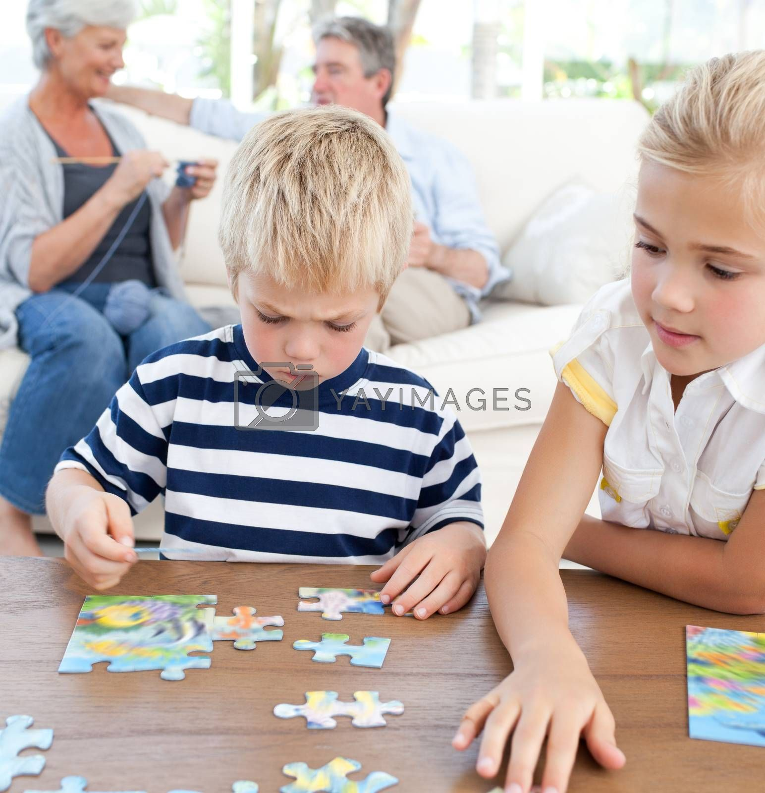Children playing puzzle in the living room