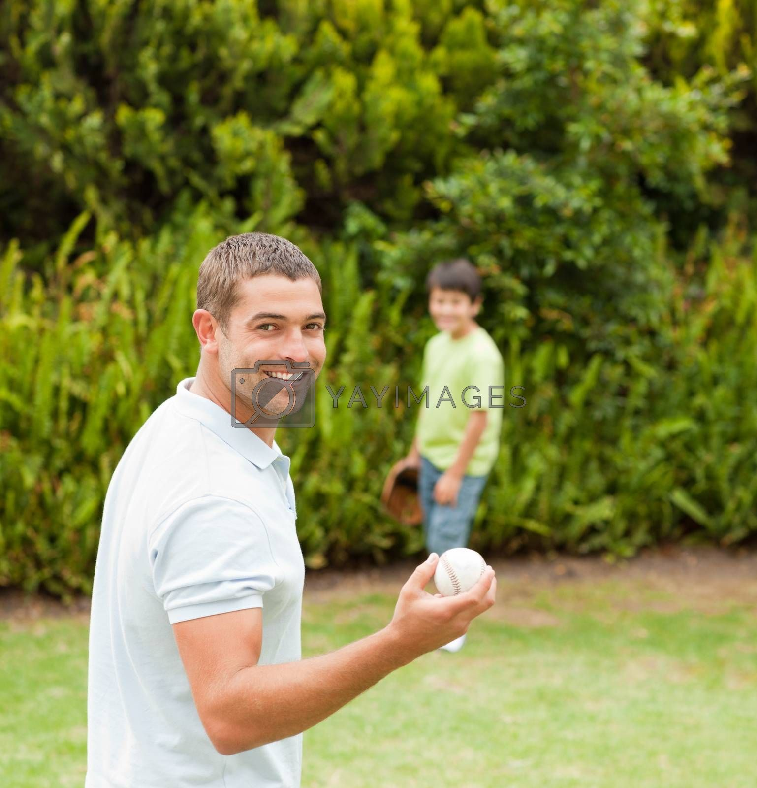 Son playing football with his father