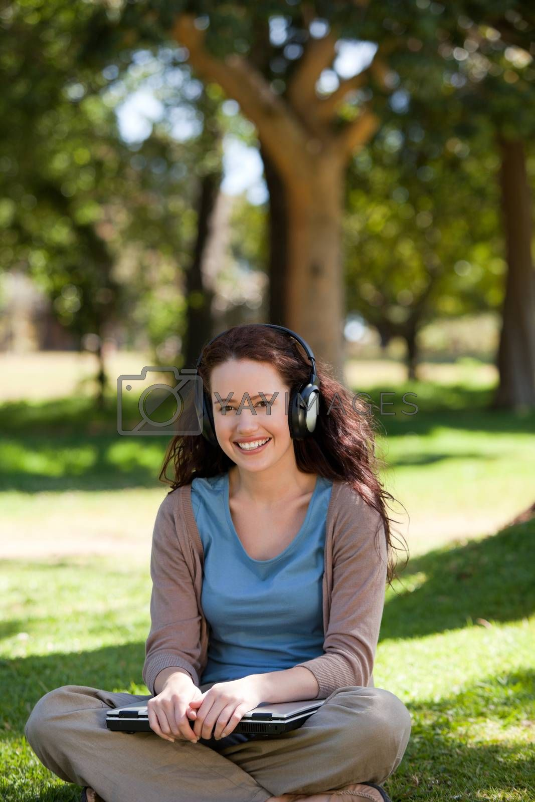 Woman listening to some music in the garden