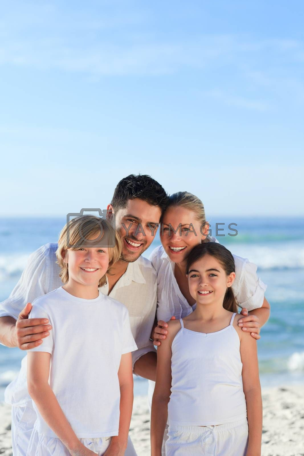 Portrait of a cute family at the beach