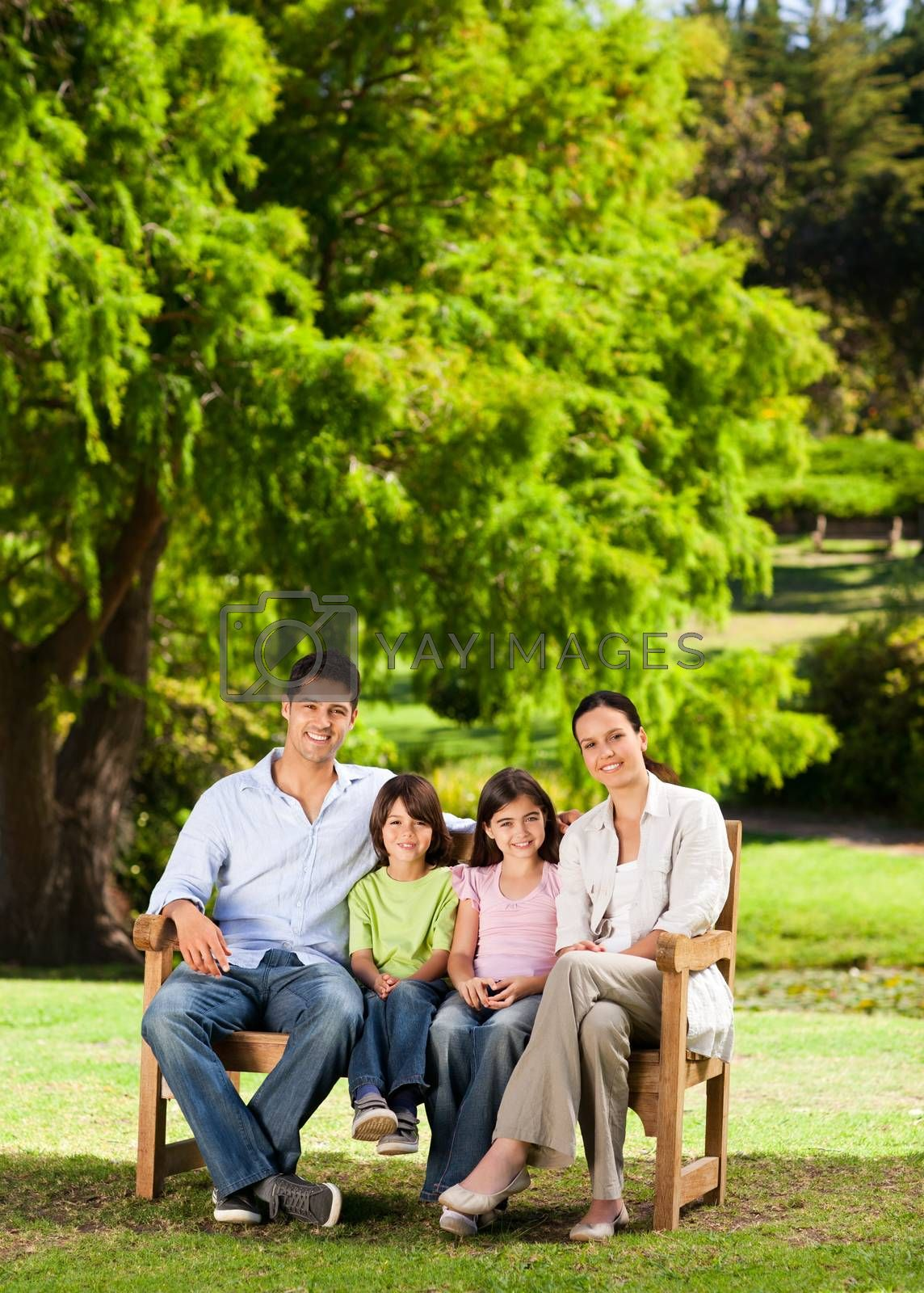 Family on the bench in a park