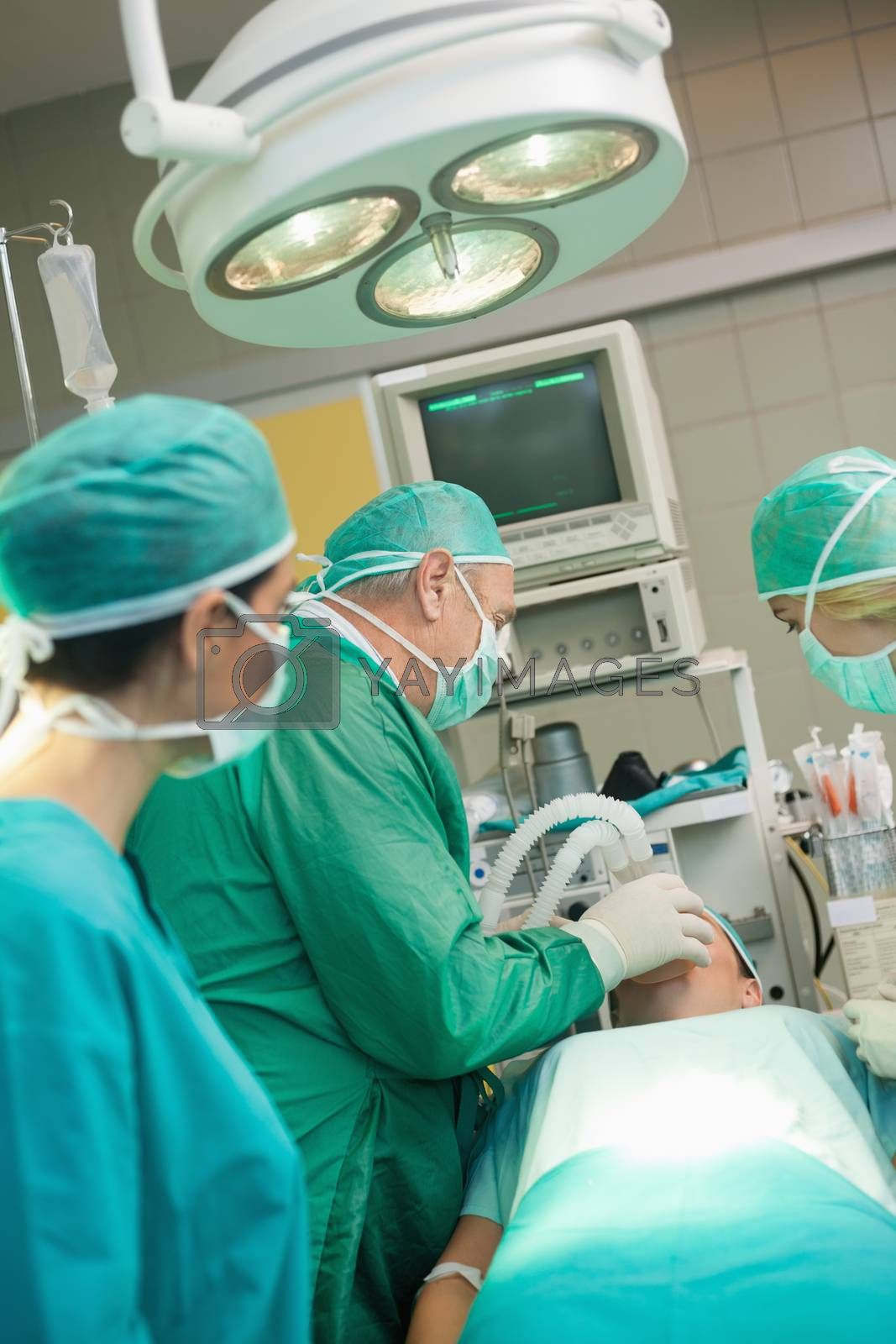 Medical team operating in a surgical room