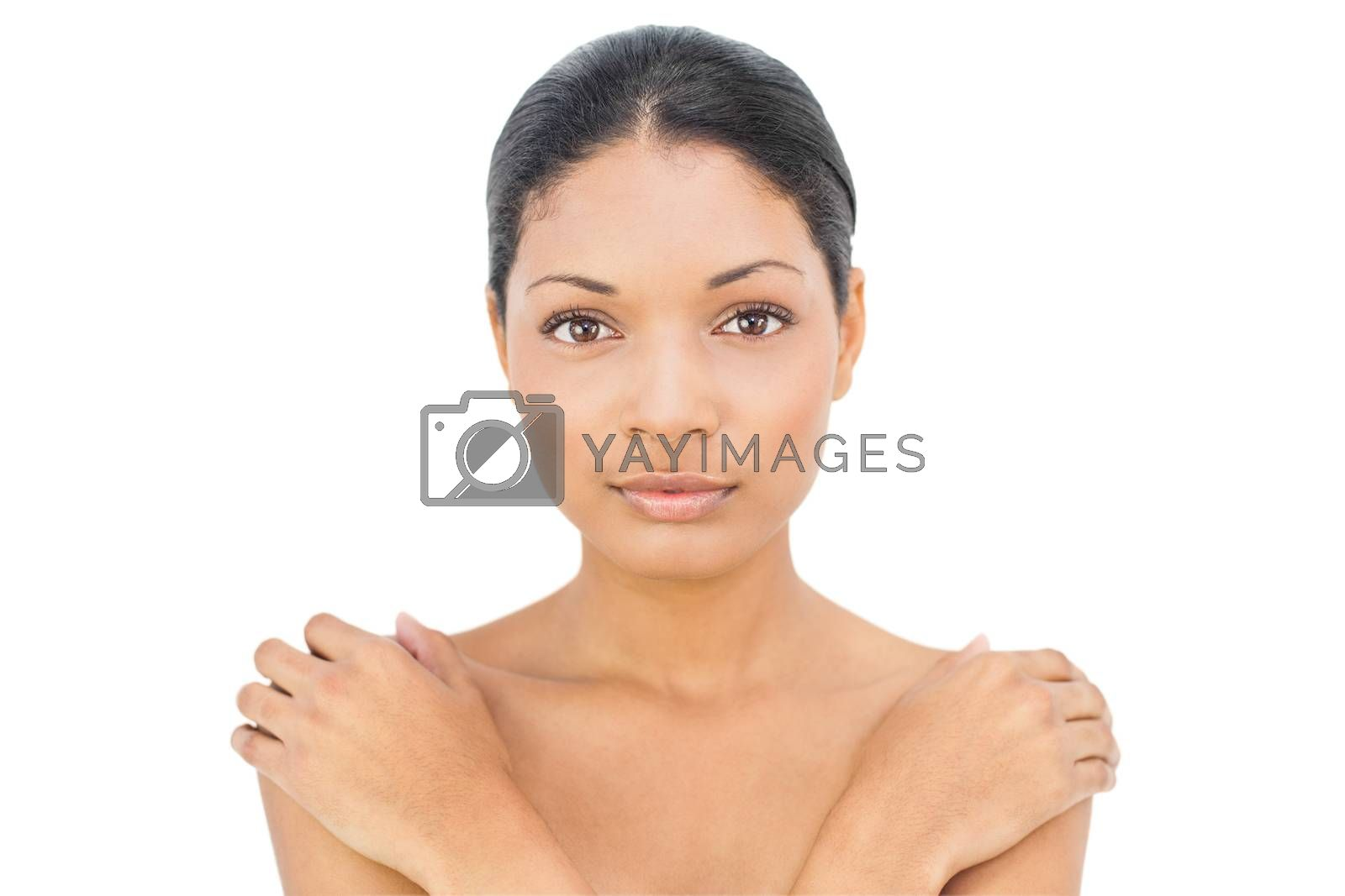 Content black haired woman posing on white background